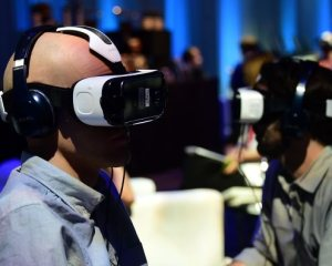 People test out the Oculus-made Samsung Gear VR Virtually Reality headset on display at the Oculus Connect 2 event in Hollywood, California on September 24, 2015. AFP PHOTO/ FREDERIC J. BROWN / AFP / FREDERIC J. BROWN